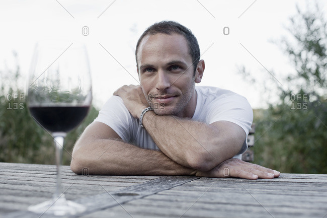A man sitting at an outdoor table, non-urban scene