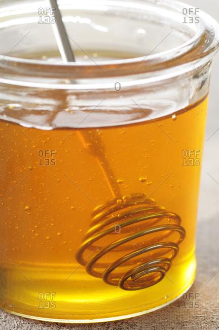 Close-up of Jar of Honey with Honey Dipper