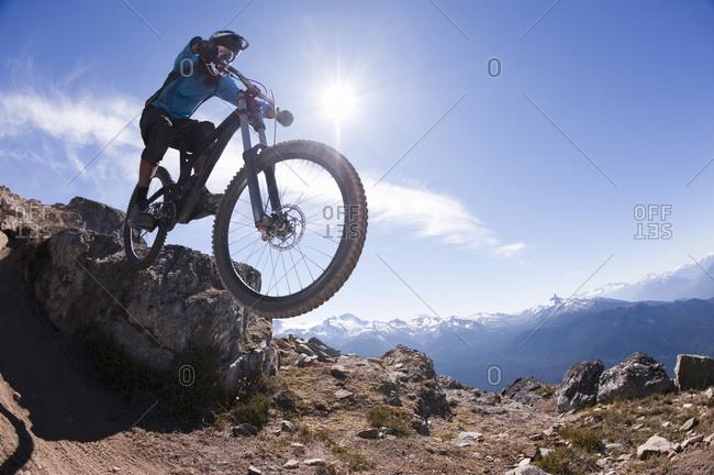 Young Man Extreme Mountain Biking, Whistler, BC, Canada