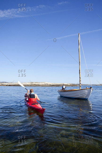 Rear view of man kayaking in river
