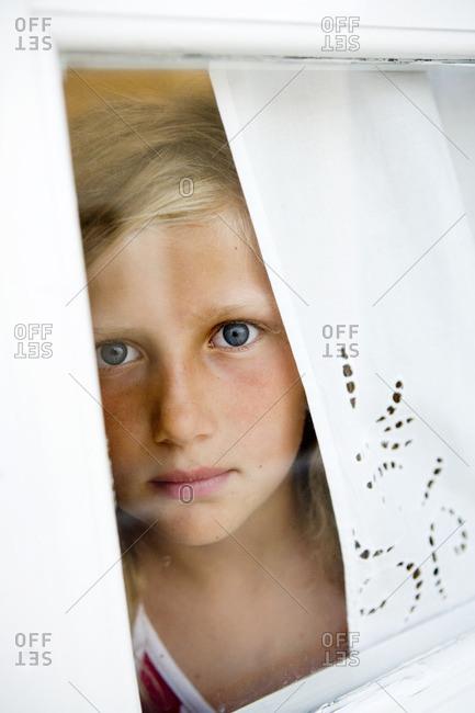 Scandinavian girl in a window