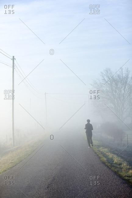 One person running on a hazy road,  Sweden