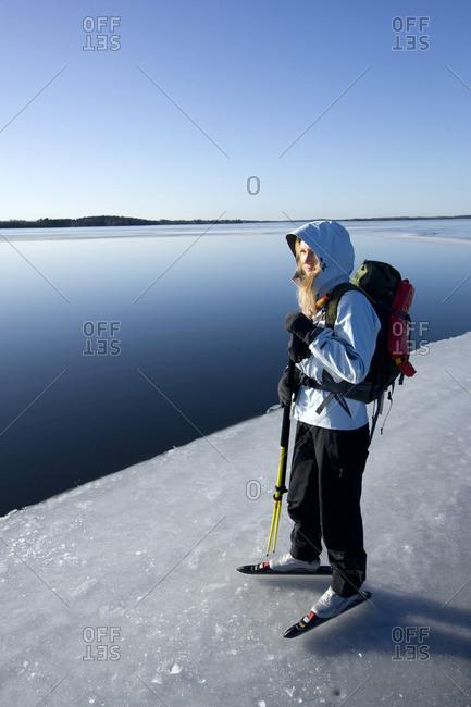 Woman standing near lake - Offset