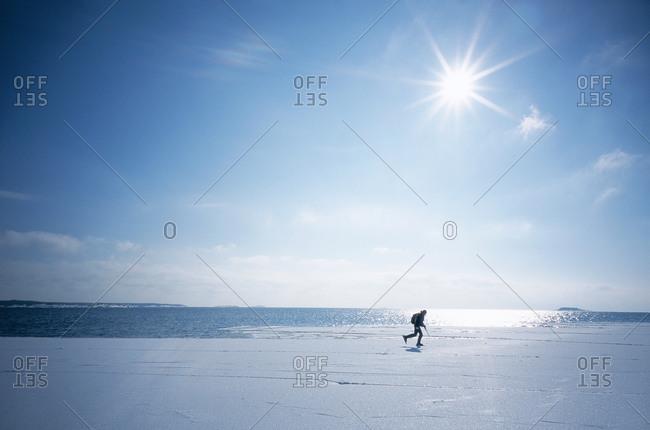 Silhouette of a person on the ice