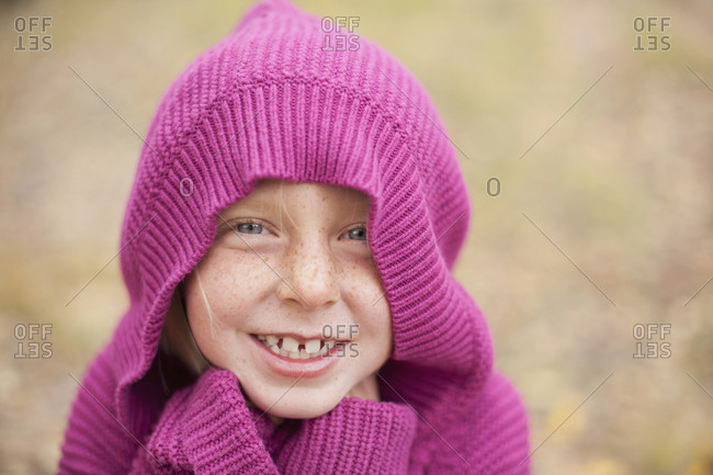 A girl in a magenta hooded sweater
