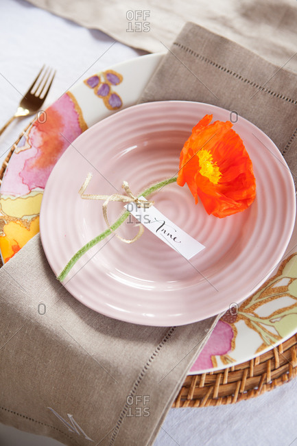 Close up of tableware with flower with label