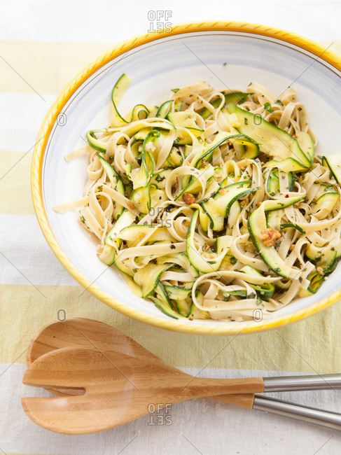 Close up of zucchini Italian pasta with toasted walnuts