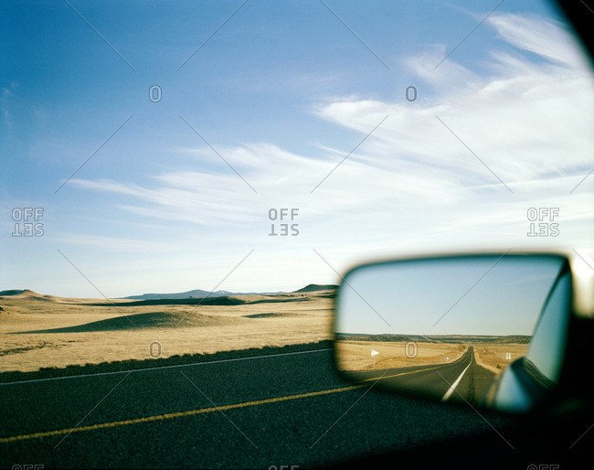 View in back mirror of the car