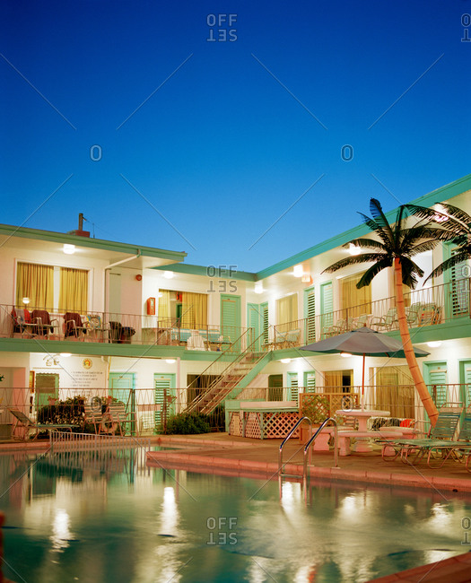 Hotel and swimming pool illuminated in evening