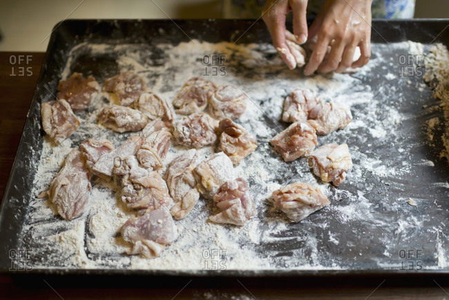 Raw chicken coated in flour