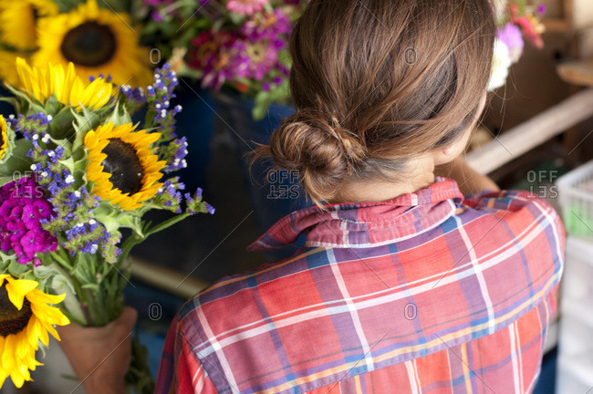 Back view of woman at a flower shop