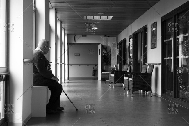 Man sitting in lobby of retirement home