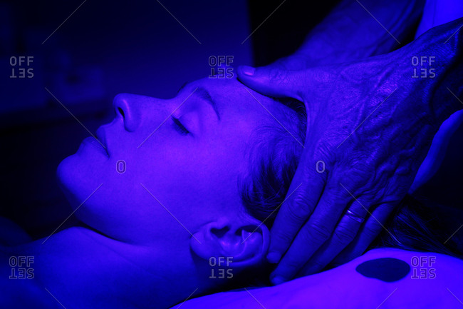 A patient is massaged while receiving chromotherapy treatment