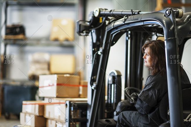 Woman driving a forklift truck