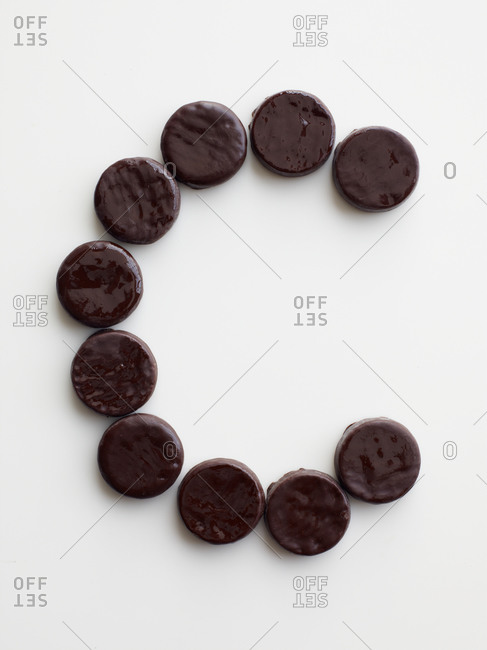 Chocolate cookies arranged in the shape of the letter C
