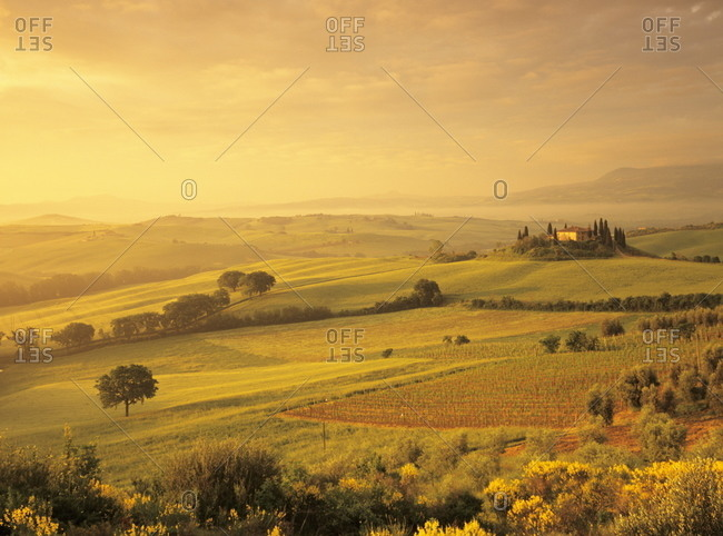 Val d'Orcia, Italy - May 16, 2008: Farmhouse Belvedere at sunrise