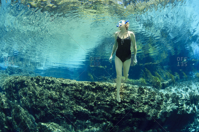 A woman returning to the surface while snorkeling