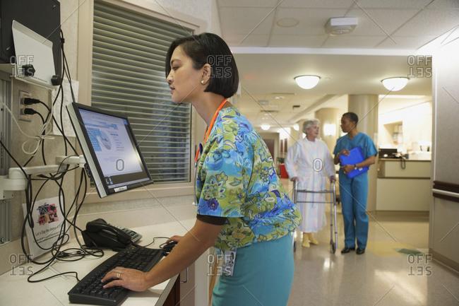 Female nurse using computer