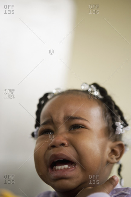 African girl crying