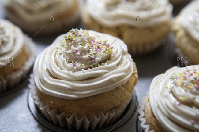 Lemon vanilla cupcakes with cream cheese icing and sprinkles