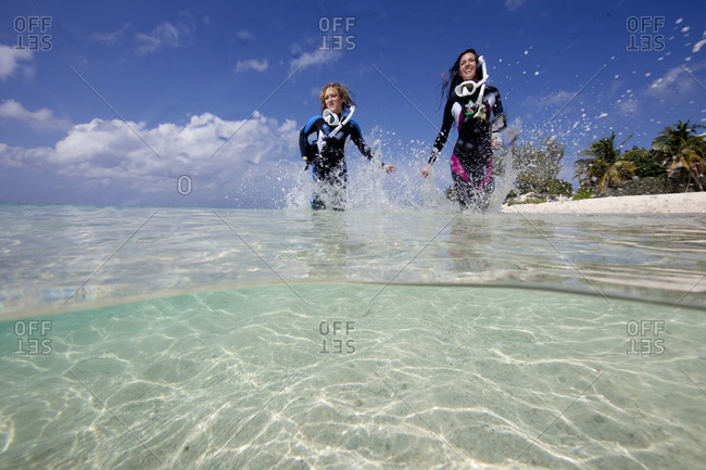 Snorkelers frolic in the surf, Cayman
