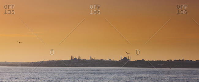 View of Blue Mosque and Hagia Sophia during sunset