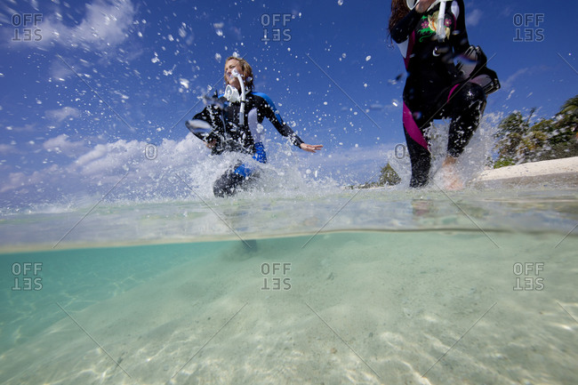 Snorkelers frolic in the surf