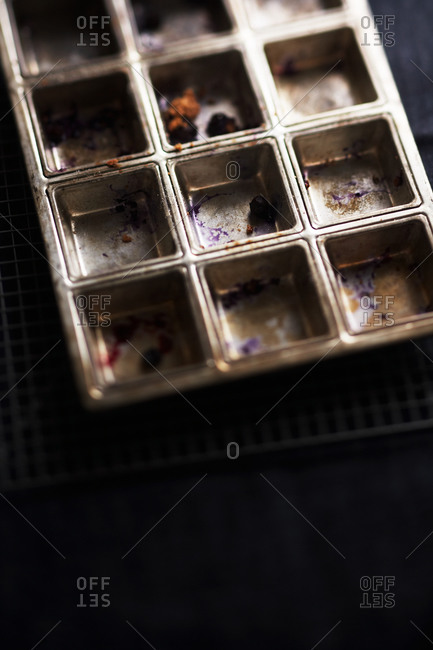 Close-up of empty, dirty muffin pan