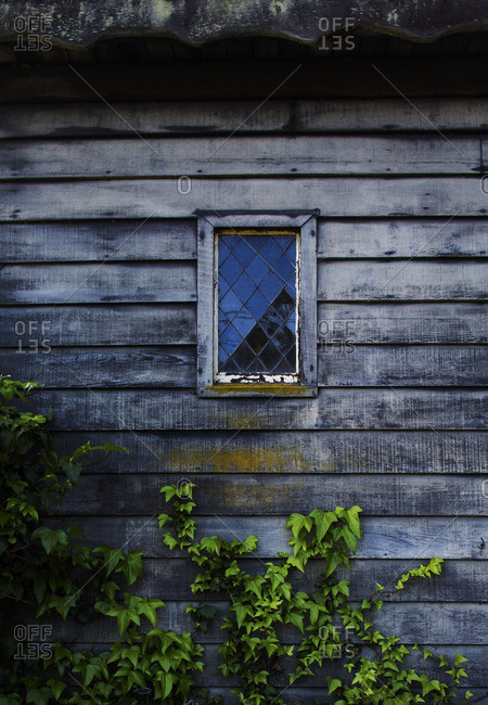 Close-up of window of wooden cottage