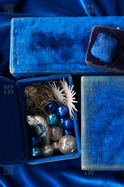 Close-up of blue ornaments and velvet gift boxes
