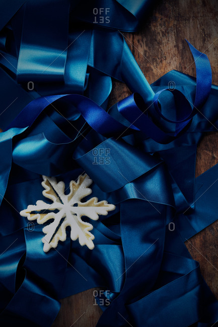 Blue ribbon with snowflake decoration