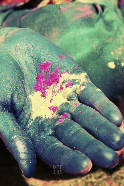 Young woman holding powder paint on holi festival