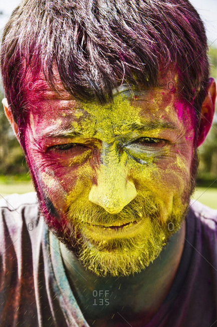 Man celebrates Holi festival with powder paints