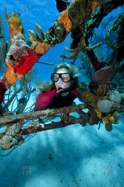 Scuba diver in middle of colorful wreckage