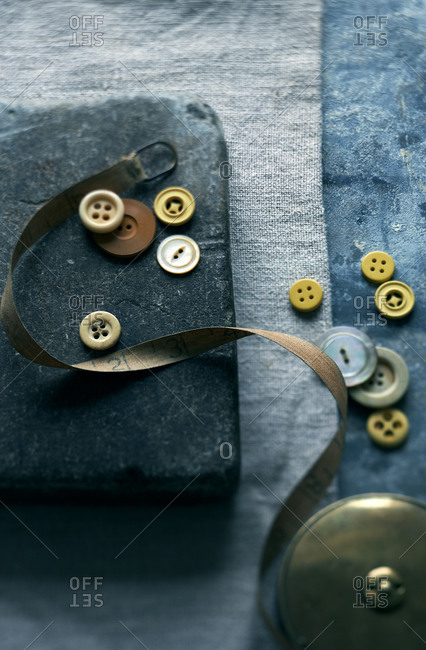 Top view of vintage buttons and measuring tape