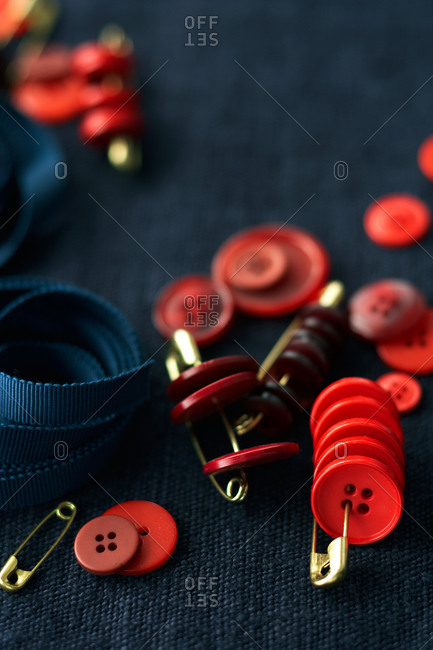 Close-up of red buttons and safety pins