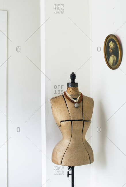 Vintage dress form standing in the corner