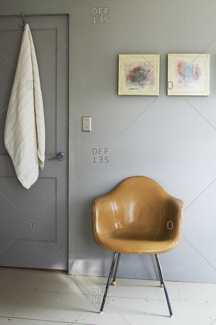 Leather chair by a closed door