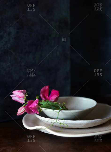 Three dishes with pink flower