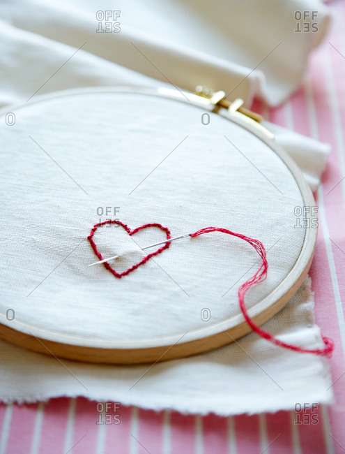 Heart embroidered with red thread