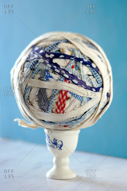 Fabric ball on an egg cup