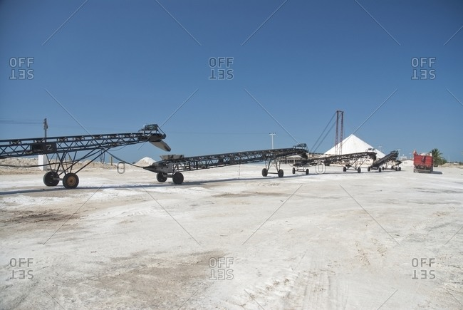 Machinery harvesting in salt field
