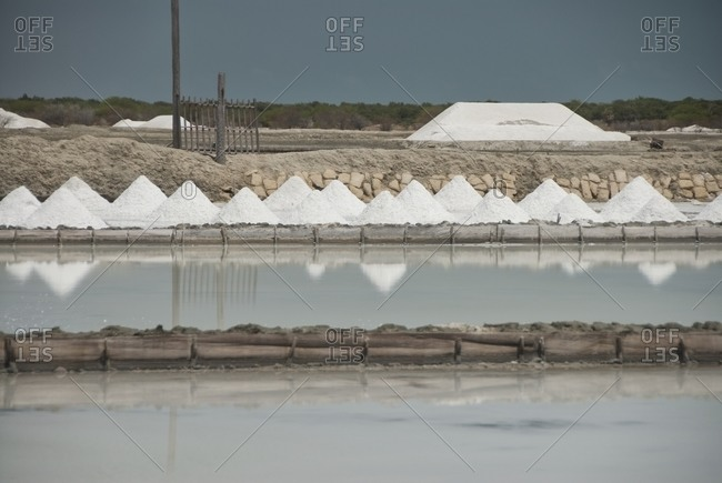 Landscape of salt piles in the salt pan in Areia Branca