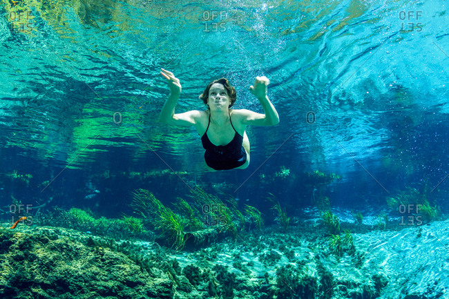 Woman swimming underwater at Florida Keys