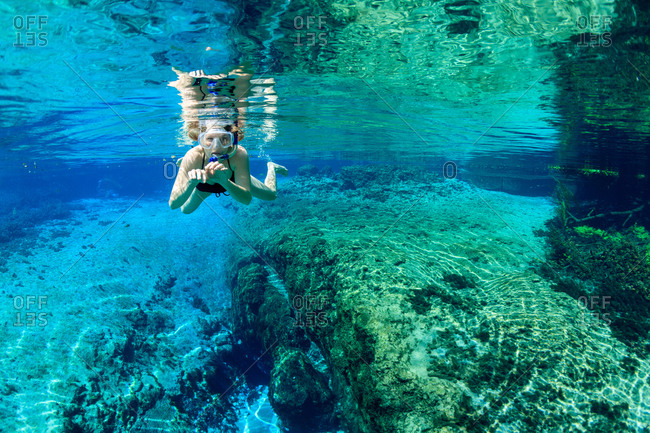 Woman snorkeling underwater in Florida spring