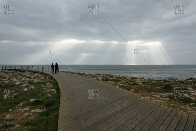 People walking on a wood path in Peniche. Portugal