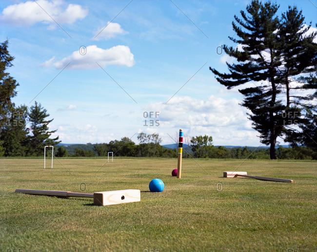 Empty sunlit croquet grass playing court