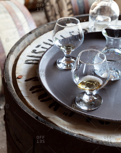 Two glasses of whiskey on a tray