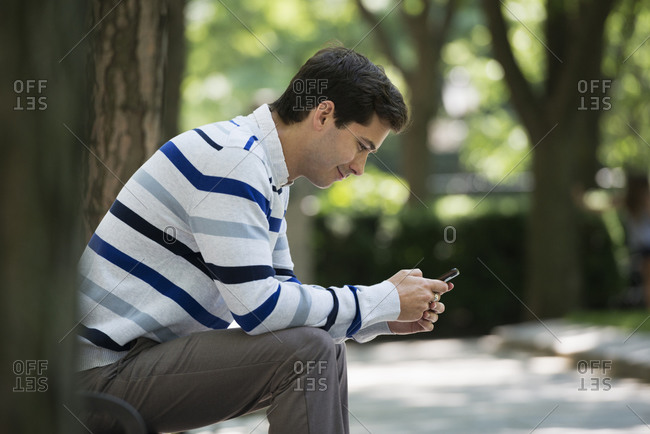 A man checking his smart phone for messages