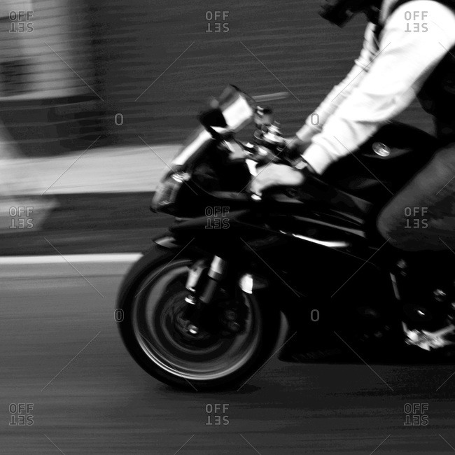 Man Riding Motorcycle - Offset Collection